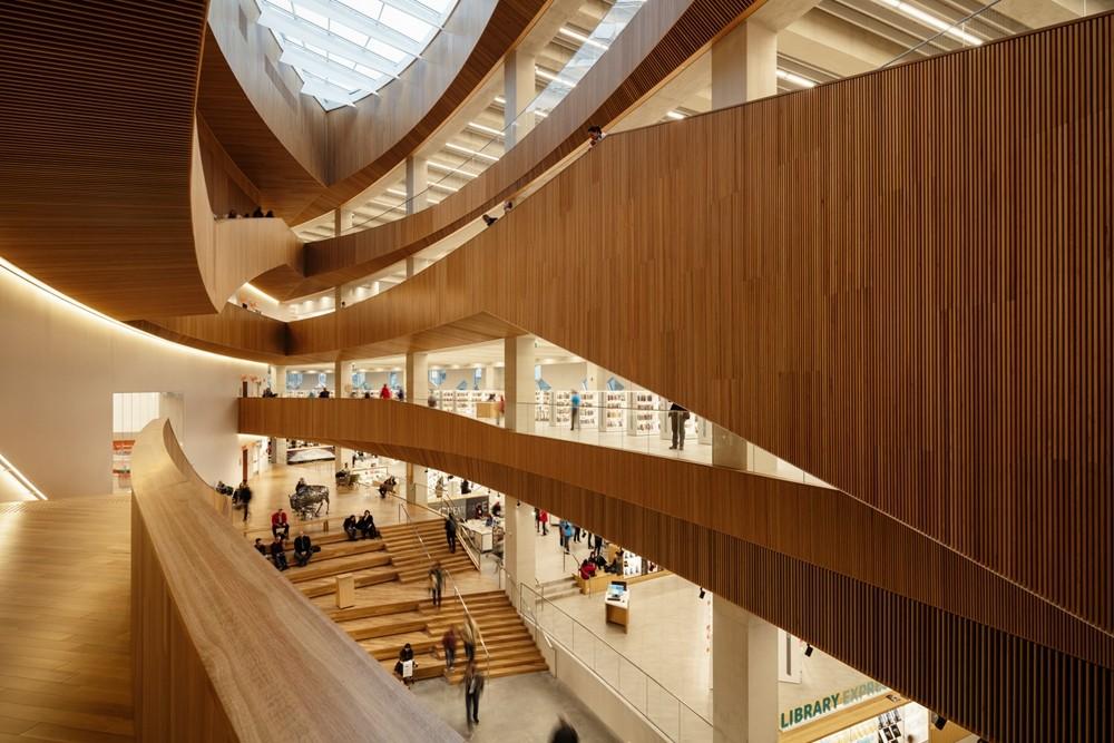 加拿大卡加利圖書館是建築也是隧道!挪威建築團隊Snøhetta打造飄在輕軌上的白色雲朵_05